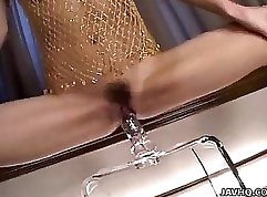 Bewitching Japanese babe welcomes dildo up her pretty mugs