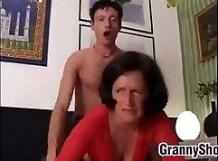 Brunette grandma strips for strangers