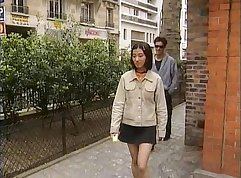 Charming and naughty Asian and Euro babe eat each others pussies