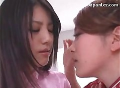 Asian donner with stockings plays with her pussy and nipples