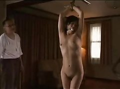 Arousing hot japanese chick sucking and stroking a large penis