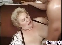 Busty granny pleased with hooker fat cock