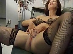 mature woman masturbating on the bed