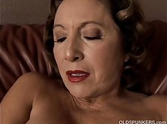 Blonde granny with too smooth pussy is getting fucked hard in a hot way