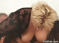 Chubby blonde mature working on her pussy